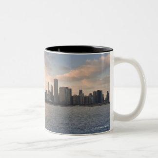 The sun sets over Lake Michigan and the Chicago Two-Tone Coffee Mug