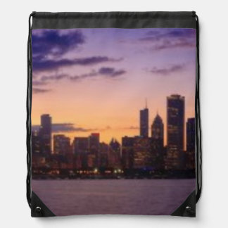The sun sets over the Chicago skyline Drawstring Bag