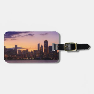 The sun sets over the Chicago skyline Luggage Tag