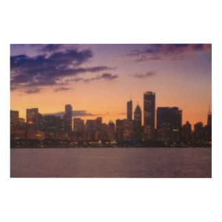 The sun sets over the Chicago skyline Wood Print