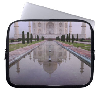 the Taj Mahal perfectly reflected in the pool in Laptop Sleeve