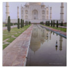 The Taj Mahal perfectly reflected in the still Tile