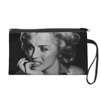 The Thinker Wristlet Clutches