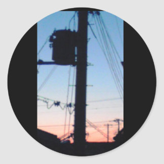 The utility pole and evening the sky round sticker