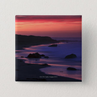 The warm hues of dawn reflect along the 15 cm square badge