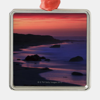 The warm hues of dawn reflect along the christmas ornament