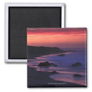 The warm hues of dawn reflect along the square magnet