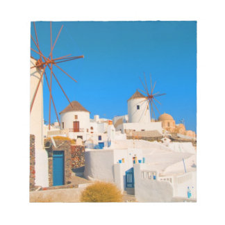 The white buildings and the windmills on the notepads