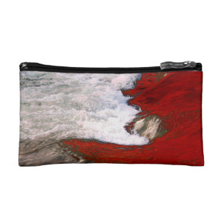 The white foam stops to the red lava river makeup bags