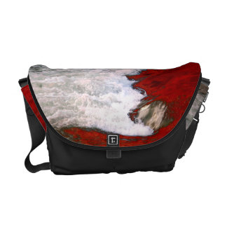 The white foam stops to the red lava river courier bags