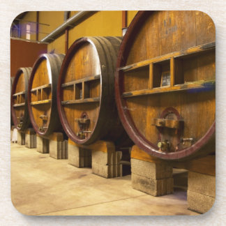 The wine cellar winery with big old wooden casks coaster