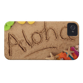 The word Aloha written on a sandy beach, with 2 iPhone 4 Case