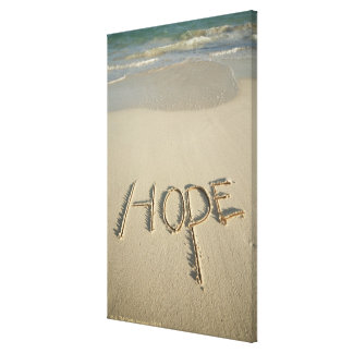 The word 'Hope' sand written on the beach with Canvas Print
