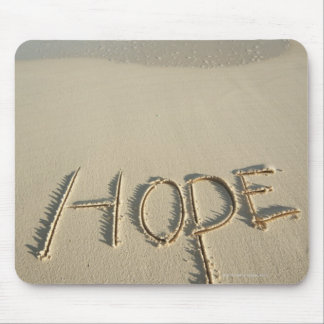 The word 'Hope' sand written on the beach with Mouse Mat