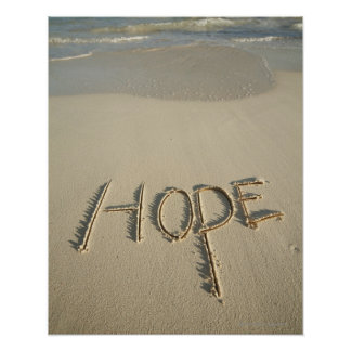 The word 'Hope' sand written on the beach with Poster