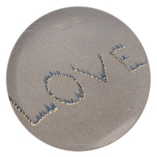 The word Love spelled out in the sand. Dinner Plate