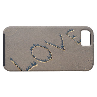 The word Love spelled out in the sand. iPhone 5 Covers