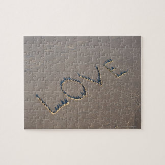 The word Love spelled out in the sand. Jigsaw Puzzle