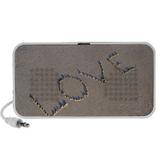 The word Love spelled out in the sand. Mini Speakers