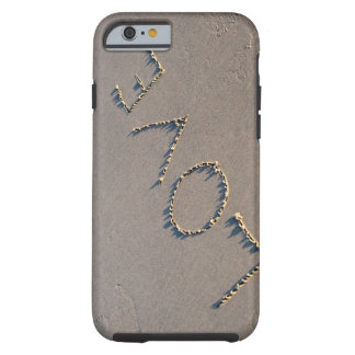 The word Love spelled out in the sand. Tough iPhone 6 Case