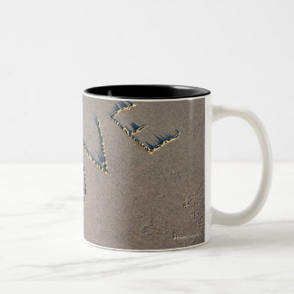 The word Love spelled out in the sand. Two-Tone Coffee Mug