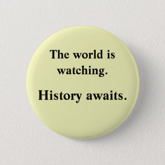 The world is watching 6 cm round badge