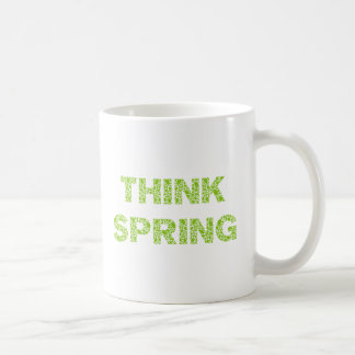think spring, text with fresh green leaves letters basic white mug