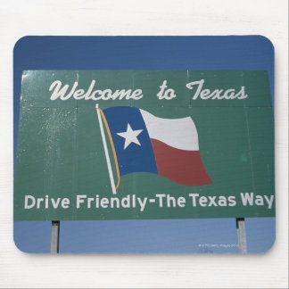 'This is a road sign that says, Welcome to Mouse Pad