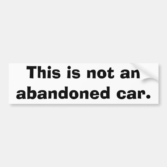 This is not an abandoned car. bumper sticker
