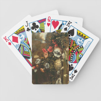 Thistles, flowers, reptiles and butterflies beside bicycle playing cards