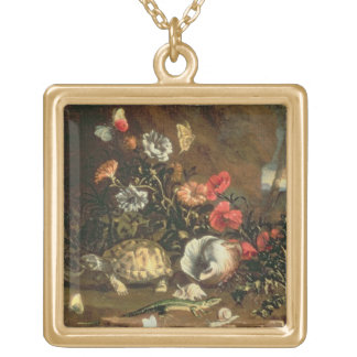 Thistles, flowers, reptiles and butterflies beside gold plated necklace