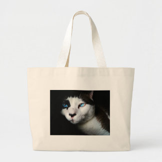 Thoughtful cat against moody backdrop large tote bag