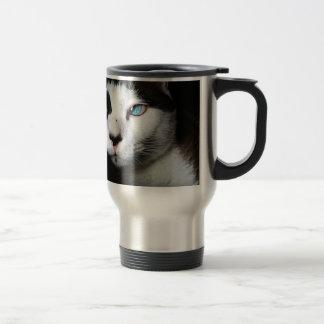 Thoughtful cat against moody backdrop travel mug