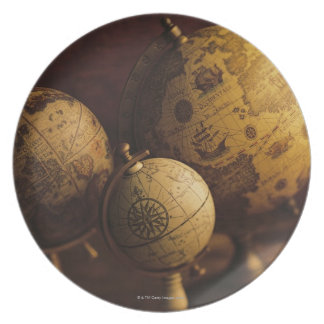 Three antique globes party plates