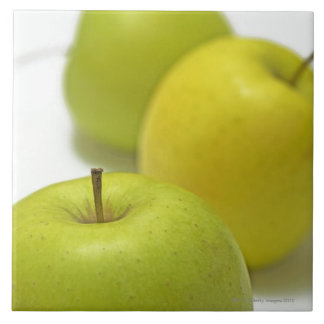 Three apples, close-up large square tile