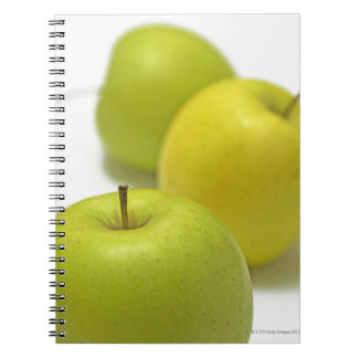 Three apples, close-up notebooks