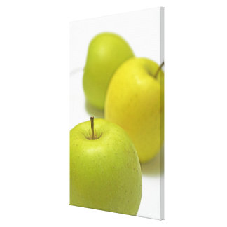 Three apples, close-up stretched canvas print