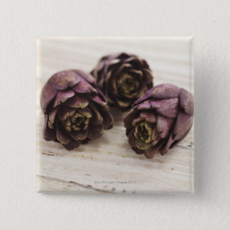 Three artichokes 15 cm square badge