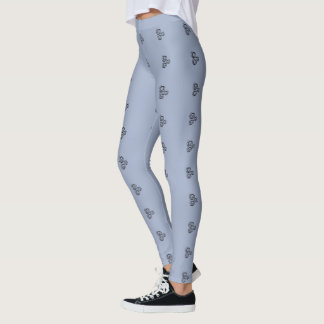 Three black swirls graphic on blue/gray legging