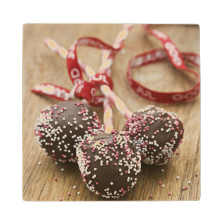 Three chocolate lollipops wood coaster