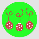 Three Christmas Baubles with stars Round Sticker