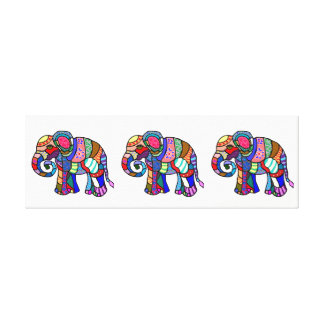 Three colorful ornamental elephants parading canvas print