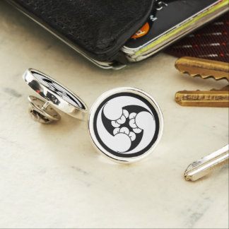 Three counterclockwise clove swirls lapel pin