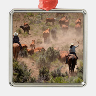 Three cowboys and cowgirls driving cattle Silver-Colored square decoration