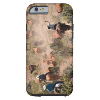 Three cowboys and cowgirls driving cattle tough iPhone 6 case