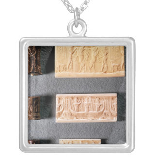 Three cylinder seals with impressions, silver plated necklace