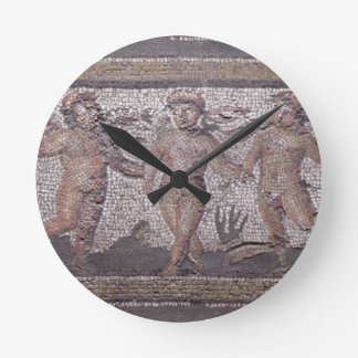 Three dancing putti accompanied by one playing the round clock