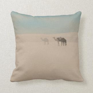 Three dromedary camels walking in Sahara desert Throw Pillows