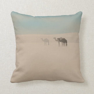 Three dromedary camels walking in Sahara desert Throw Pillow