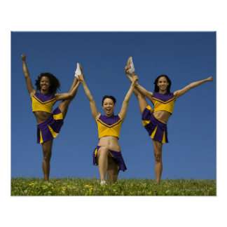 Three female cheerleaders doing formation poster